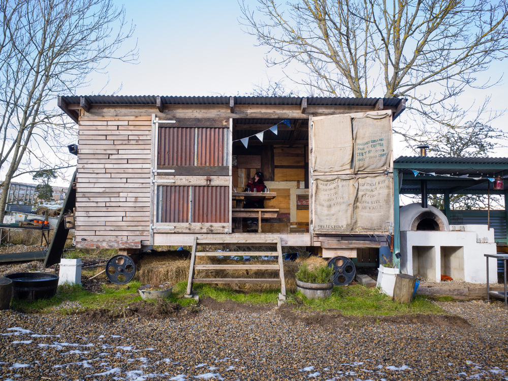 A dining wagon next to an outdoor kitchen on site. This would be lush during the summer!