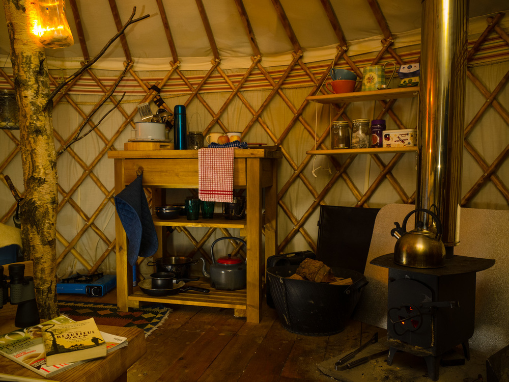 A wood burning stove provided heat and a place to cook. The mini kitchen included everything we needed to cook up a fried breakfast in the morning.     It's not the most pleasant thing to wake up in the morning being able to see your breath, knowing that the only way that you're going to feel comfortably warm is to get out of bed, into the cold and get the matches out.   I must admit that over the weekend, I learnt a thing or two about lighting a good fire.