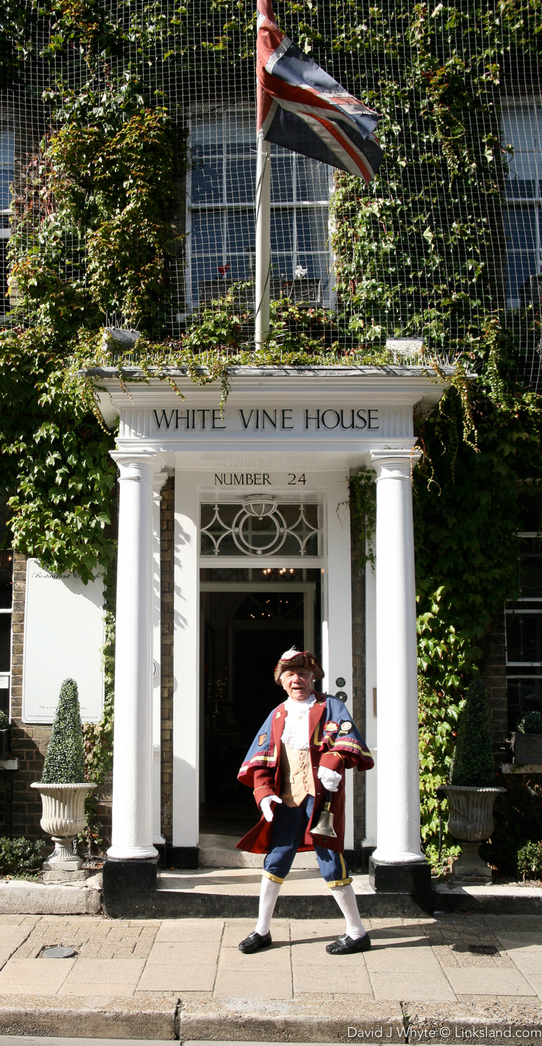 Rye's Town Crier - the Google of Yesteryear - outside Rye's White Vine House Hotel