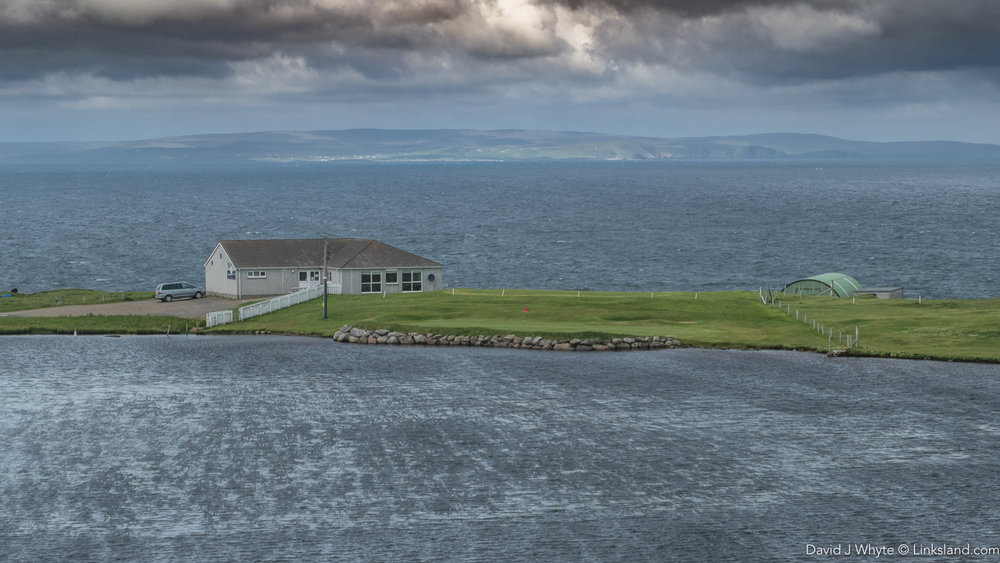The 18th at Whalsay sits behind a loch with the North Sea surrounding the golf course.