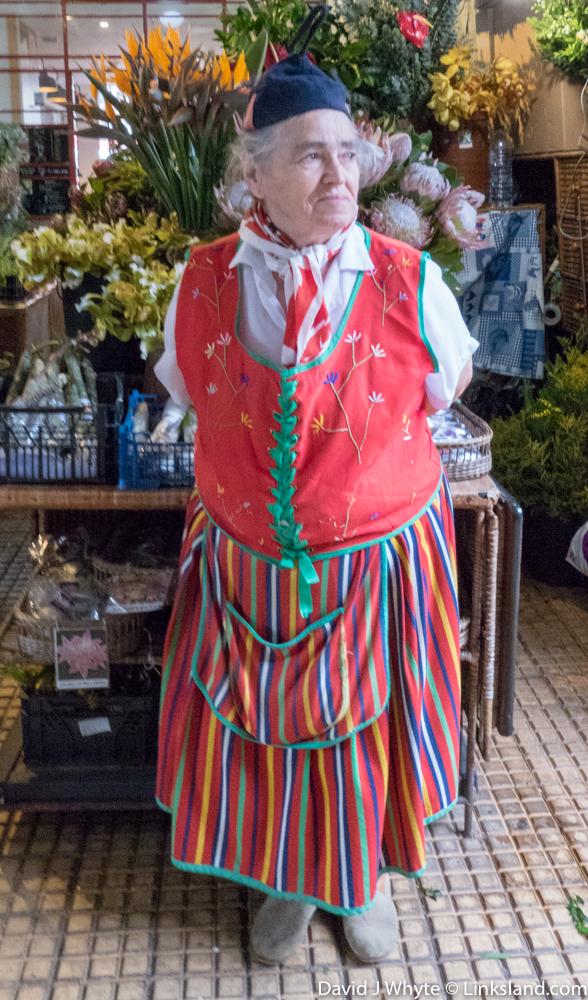 Flower-sellers wear traditional folk costume in the Worker's Market. They dance the Bailinho da Madeira, the traditional Madeiran folk dance.