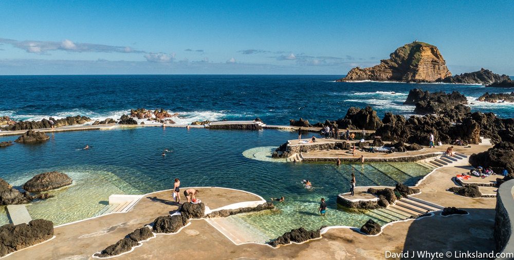 Porto Moniz volcanic rock pools where in the summer everyone arrives to sunbathe. it's a government facility.