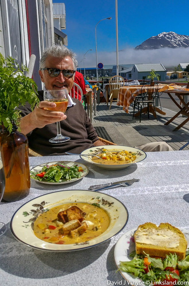 Your author soaking up the local sunshine and  soup du jour  at   Gisli Eirikur Helgi Kaffihûs Bakkabrædra   in Dalvik. The seafood, as you can imagine is some of the best in the world.