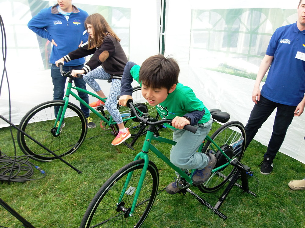 Guess which kid is cycling on the bike connected to the evaporation unit? © Livingston Group