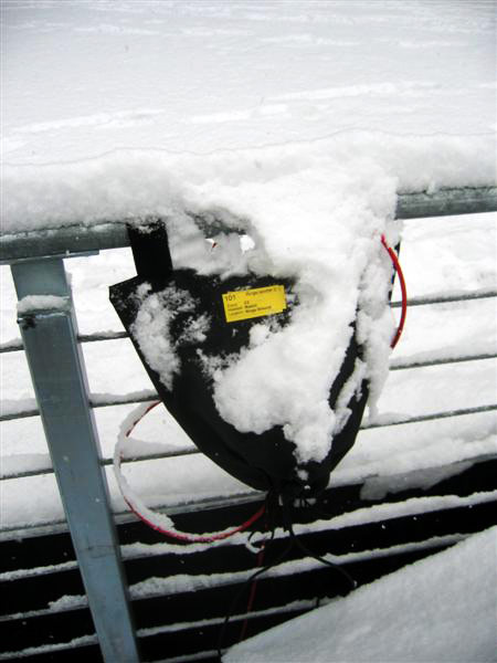 Pete Erskine designed storage bags for the outdoors equipment. The bags opened at the bottom and were fastened with Velcro at the top. This allowed humidity to escape and wires to stay attached to the beltpacks.  Here's one after the first snowstorm.