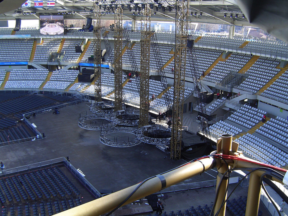 The Olympic rings in the performing stage position.  No platforms. The performers climbed and suspended from the rings.