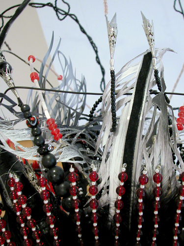 Headdress #1  (detail), 2006 Metal, foam, wood, metal and glass beads, silver wire, feathers, fur, magazine cutout, xacto blades, rifle cleaners and acrylic paint Variable dimensions