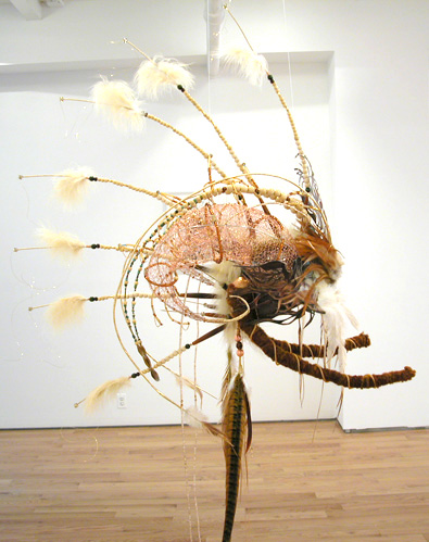 Headdress #1 , 2006 Metal, foam, jade, turquoise, crystal, glass, bone, wood, clay, metal beads, feathers, gold & copper wire, suede, yarn, copper chain, magazine cutout, and acrylic paint Variable dimensions