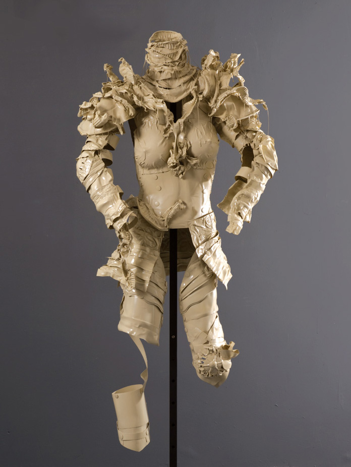 Suit of Armor #2,   2010 Recyclable plastic containers and lids, glue, spray paint, clear glaze 56 x 28 x 18 in | 142 x 71 x 46 cm