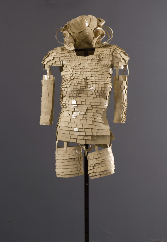 Suit of Armor #3,  2010 Recyclable plastic containers and lids, glue, spray paint, clear glaze 40 x 24 x 18 in | 231 x 61 x 46 cm