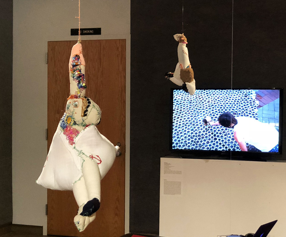 two hanging sculptures by Maja Ružnić, 'Leaning Woman' and 'The First Phantom', from her series 'Phantom Caravan'; and 'ŠTO TE NEMA - Boston', a documentary film of Aida Šehović's installation/community-based work (film by Rialda Zukić) – in 'Proof of Existence' at WKU
