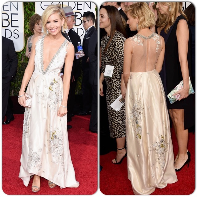"This embroidered gown achieves the popular ""cut down to there"" plunging neckline while remaining sweet and ladylike. I give it props for its uniqueness among the others of the night."