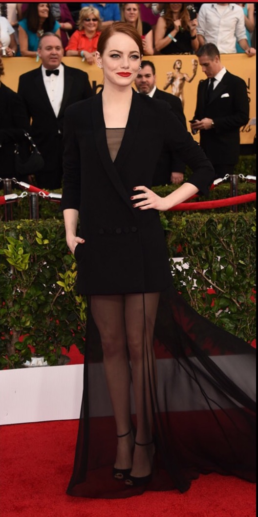 I didn't think Stone deserved being on the Worst list, as - like she did at the Golden Globes by wearing a black and silver jumpsuit with a train - I admire her effort to be edgy and different. But that's just the problem - this look has too similar of a feel to that look, thus making it not that different at all. I would have been more impressed to see Emma Stone in a colorful gown (like her 2011 Golden Globes peach Calvin Klein), which would've showed her ability to be a chameleon.