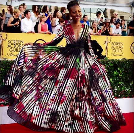 What a gorgeous combination of color and print. I'm a big fan of print, and it's not super prevalent on the red carpet, so I get excited to see it worn successfully. This gown proves one doesn't have to show a ton of skin or curves to be dramatic. Another aspect of this style that I love is that hues and long sleeves is season appropriate for January, something that (understandably) in California and on the red carpet is overlooked.