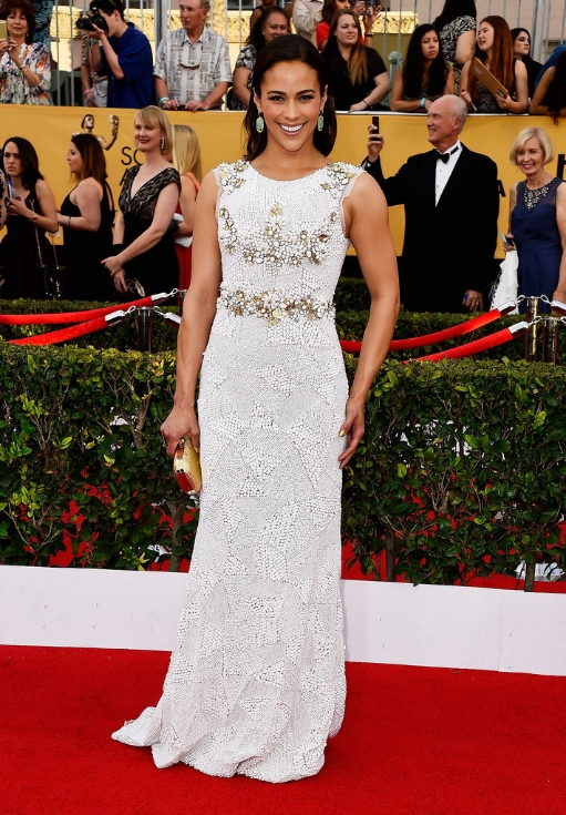 The actresses' olive skin glows in this gorgeous white beaded-head-to-toe gown.