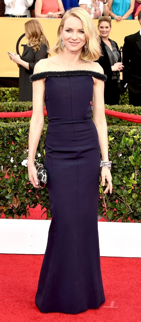 In fairness, I am usually not a fan of off-the-shoulder silhouettes such as this one, even on a narrow frame like Watts'. But what really landed this dress on the Worst list for me was the tinsel-like edging on the neckline. For the record, I love her accessories. And the navy color. The tinsel just kills the look for me.