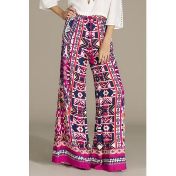 Palazzo pants are back! Resist the urge to go matchy-matchy, and instead, pair printed palazzos with a neutral top. And to keep proper proportions, select a fitted or slightly cropped top (as shown with the Flying Tomato boho hippie palazzo in magenta). Image credit: shopwsw.com