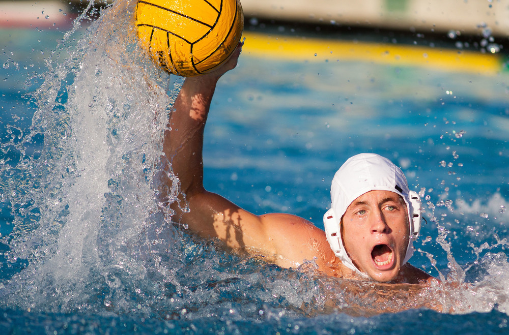 A Riverside men's water polo player looks to pass during a game against Golden West College at Golden West College.