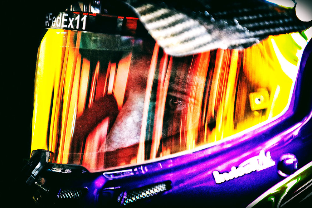 DAYTONA BEACH, FL - FEBRUARY 24: (EDITOR'S NOTE: Image was processed using digital filters.) Denny Hamlin, driver of the #11 FedEx Express Toyota, sits in his car during practice for the 59th Annual DAYTONA 500 at Daytona International Speedway on February 24, 2017 in Daytona Beach, Florida. (Photo by Tim Bradbury/Getty Images)