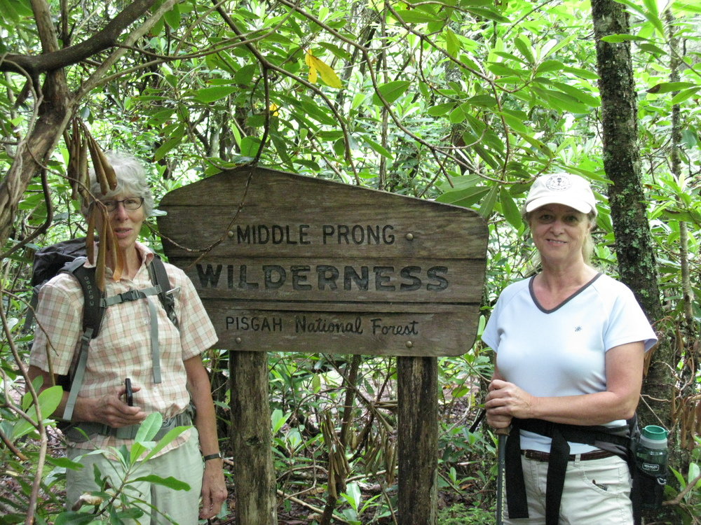 Maribeth Weinman (left) and Linda McCorkindale pose alongside the Middle Prong Wilderness sign.