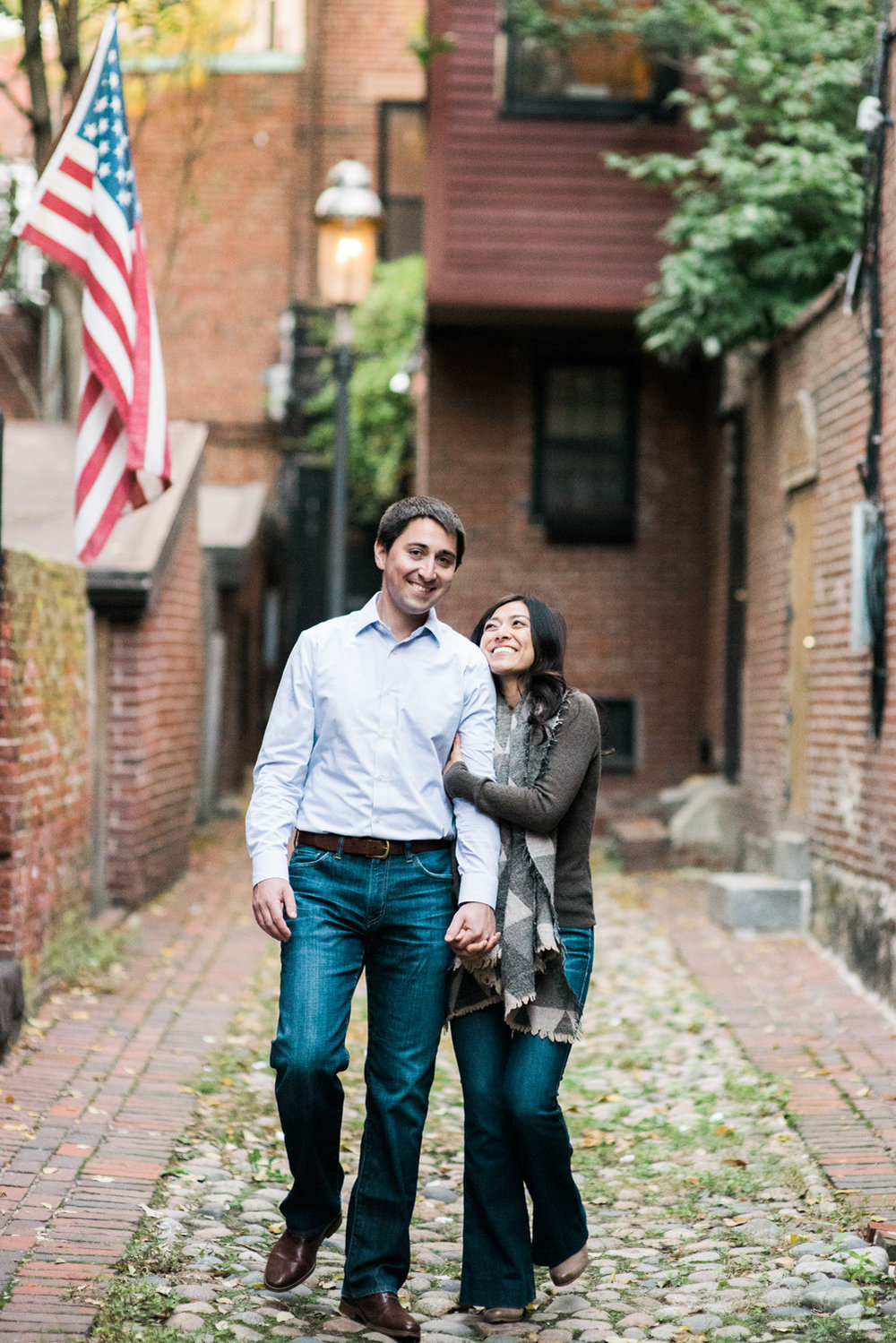 Engagement Photograpy couple walks down cobble stone street in Boston