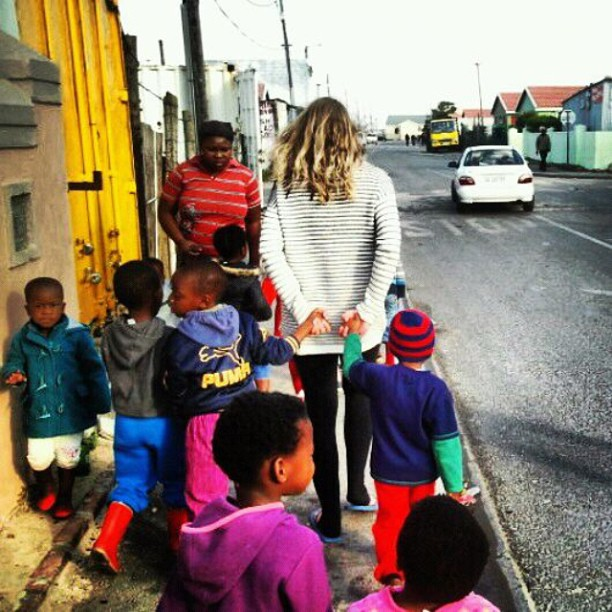 A photo I snapped of Julie walking in Masi with a bunch of Rainbow kids—Joshua on her left, Kholisani on her right.