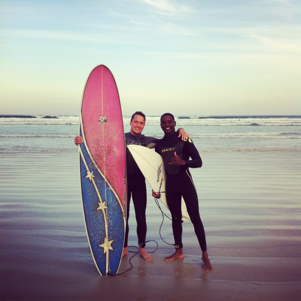 Mandla and me heading out for a casual paddle at Muizenberg in June 2013.