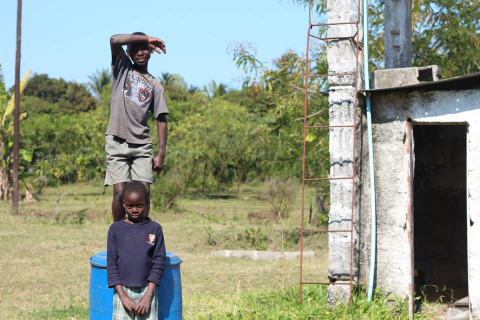 Moses at Toni in the soccer field at  Kedesh Orphanage & Sanctury , Chamba, Mozambique.