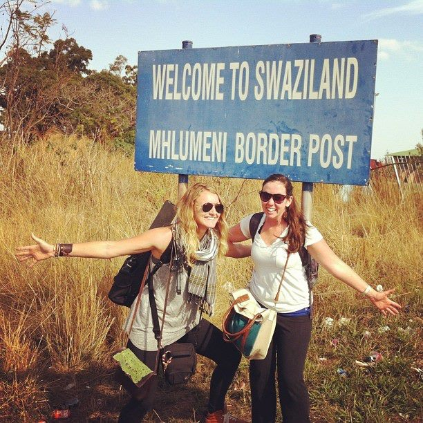 Abby and I snapping a quick shot with the Swaziland border sign on our way out of the country.