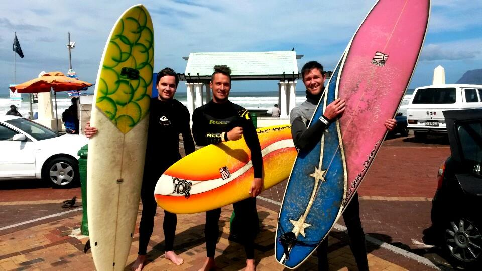 Chase, Greg and me heading out for a surf at Muizenberg Beach.
