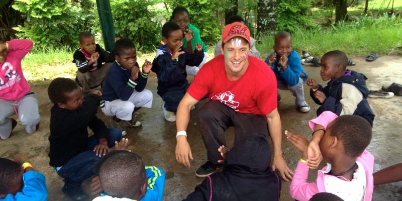 Playing a musical game with the children in Swaziland.