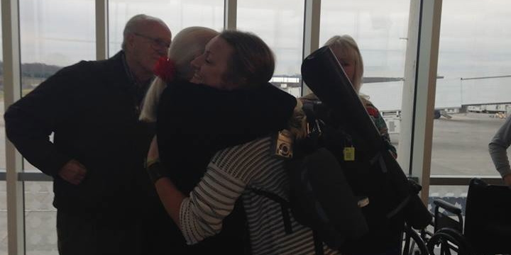 Receiving a welcome home hug from my grandmother at the airport.