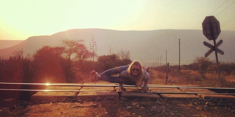 Doing a yoga pose on the railroad tracks in Nsoko, Swaziland.