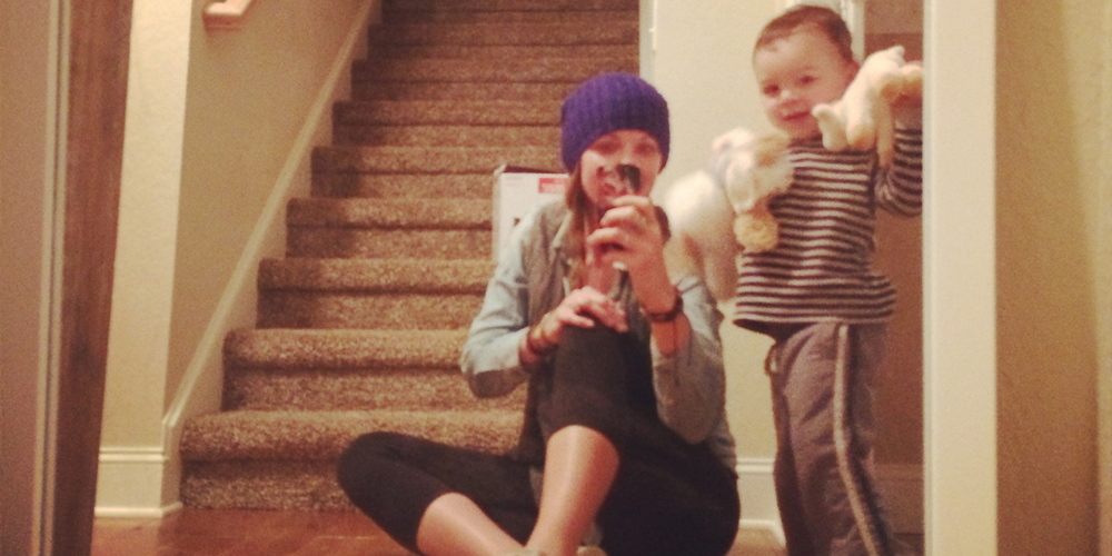 My nephew,Britten, and me having a little mirror photo op at his house.