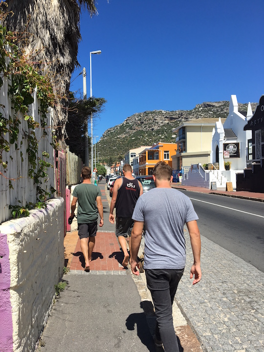 Walking from Muizenberg to Kalk Bay with Fanus, Ross, and Richard.