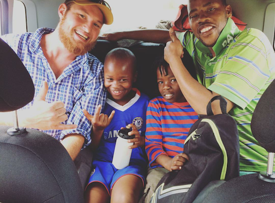 Ross on the drive home from soccer practice with Owen, Quanele, and Luyanda.