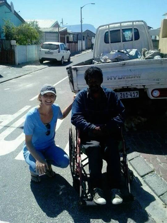 Julie and Redwaan in his new wheelchair.