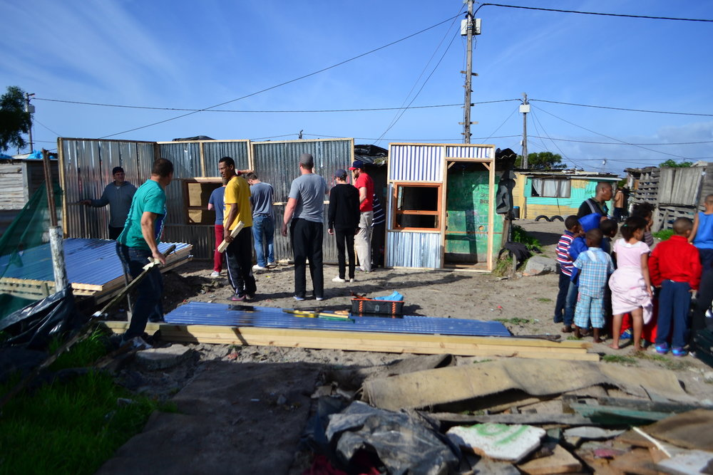 A missions team from Detroit, MI helped Restoring Hands build a new house for a soup kitchen family.