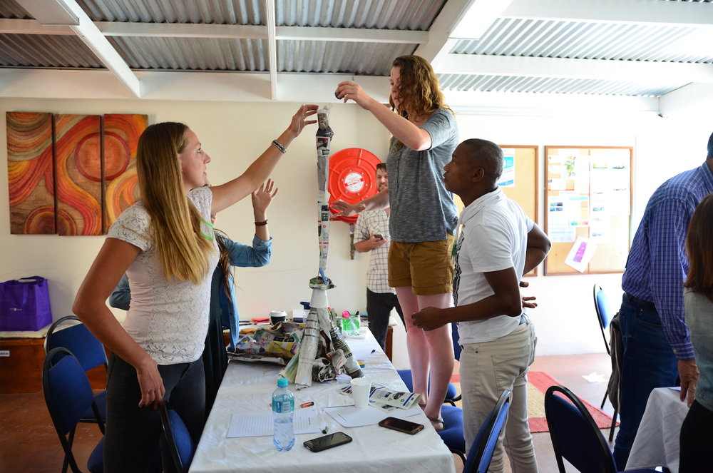 Miranda, Cayla,Sydney, and Ronald of Future Life doing a team building activity at a Yebo Life workshop.
