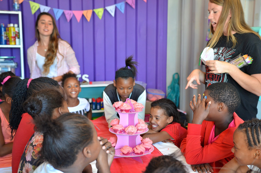 Sydney and another leader, Cayla, competing against cupcakes for the girls' attention.