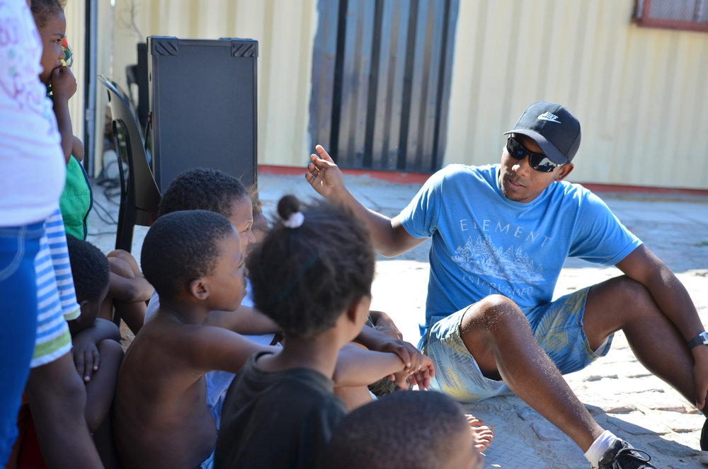 YWAM team member, Krishna, working with some of the kids at Rise Up