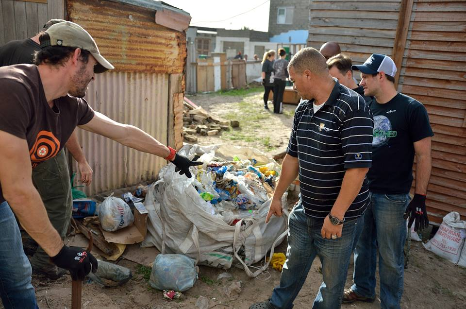 Clayten, along with members of Yebo Life, Restoring Hands, and Grace Christian Church, building a new house for a Lavender Hill resident