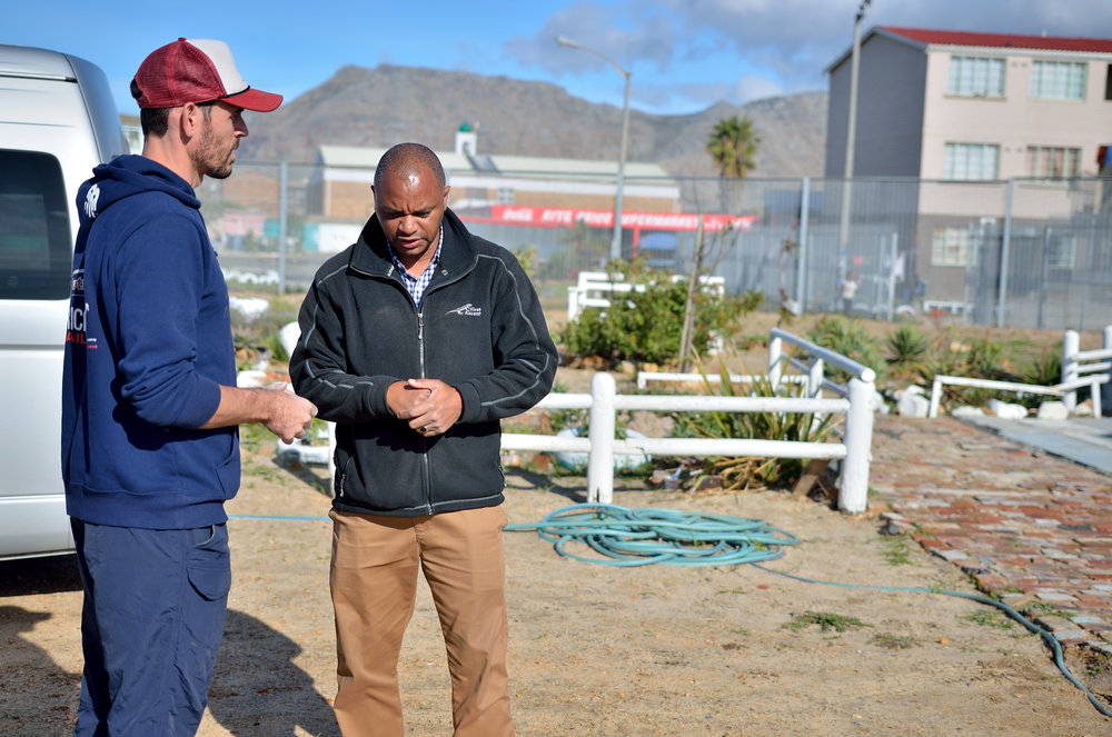 Clayten and Ivan chatting at the Revelation Ministries base in Lavender Hill.