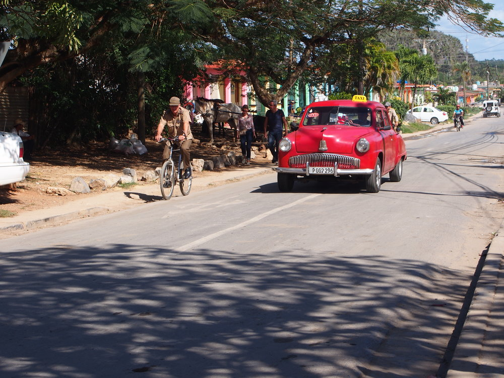 The town of Viñalas where bikes, horse-drawn carts, tractors and vehicles of all makes and vintage share the road.
