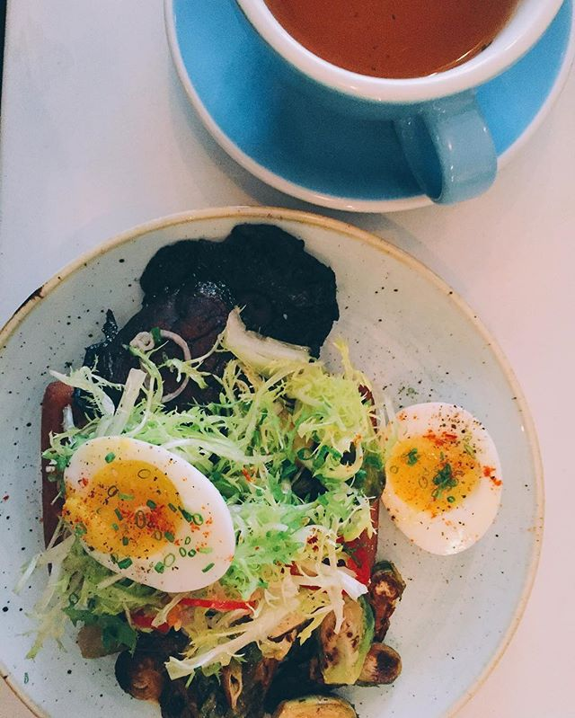 { Brunch gets serious today. Gluten-free sweet potato waffle, frisée, eggs, Brussels sprouts, and mushrooms. Green tea}