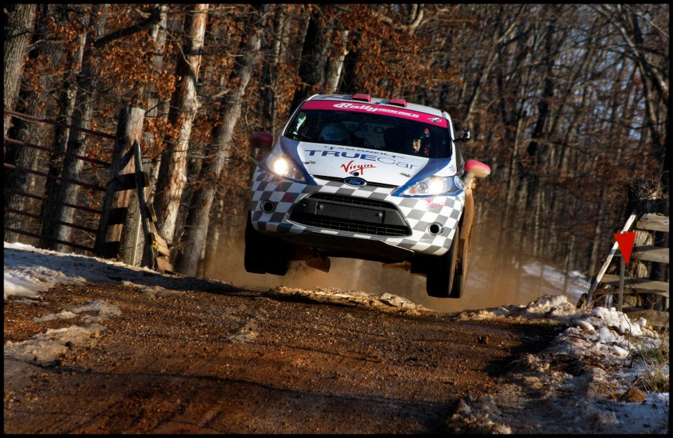 Jump over a cattle guard at 100 Acre Wood Rally.  Photo by Elliot Sherwood
