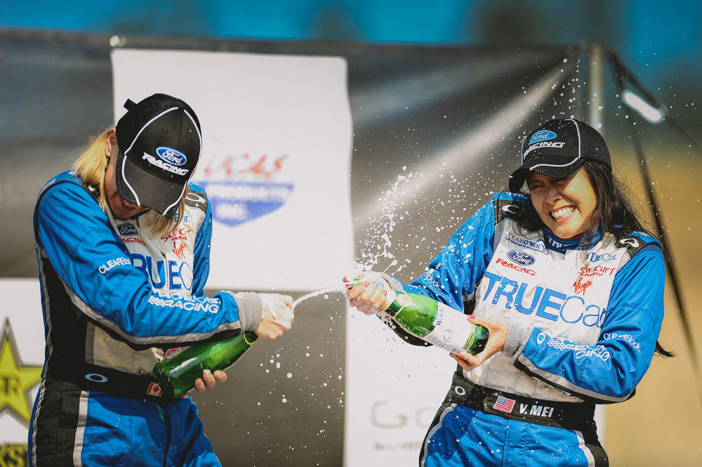 Verena  &  her co-driver Leanne celebrate the Rally America B-Spec championship on the podium.  Photo by Alex Wong - emotiveimage.com