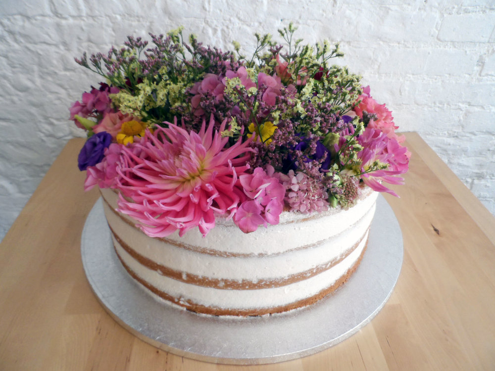 Naked wild flowers wedding cake
