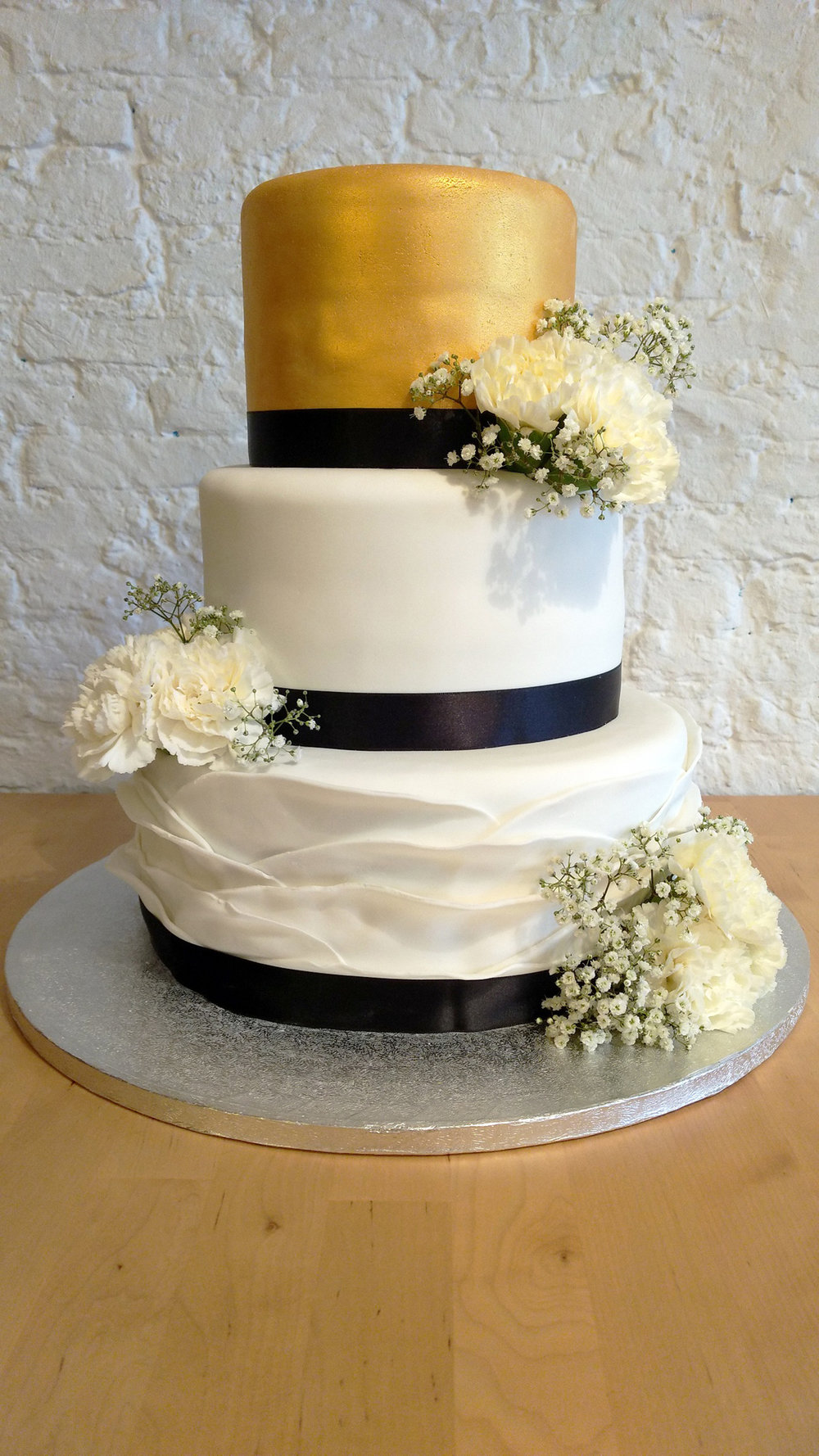 Gold white ruffle wedding cake