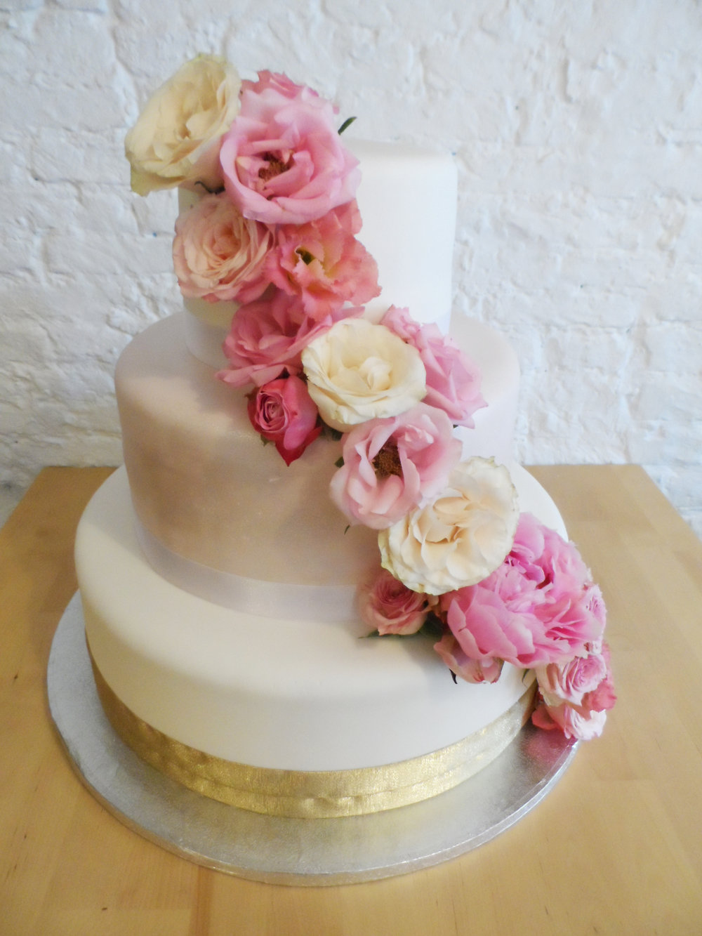 pink gold flowers roses waterfall cake